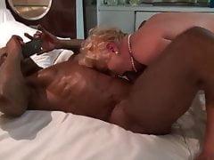 Granny sucking big black balls.